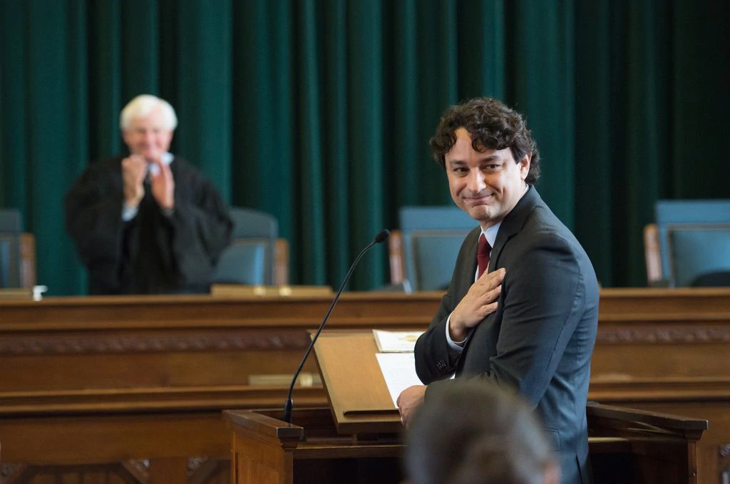 Antonio Massa Viana smiled at his family after he was sworn in to the Rhode Island bar.GRETCHEN ERTL FOR THE BOSTON GLOBE